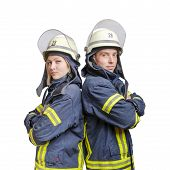 Young Couple Of Firefighters With Folded Arms Standing Back-to-back Wearing Uniform And Helmets. Iso poster