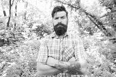 Summer Style. Bearded Man Keeping Arms Crossed In Casual Style On Natural Landscape. Brutal Hipster  poster