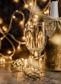 New Year Concept. New Years Eve Dark Party Table With Two Champagne Flute, Shiny Bottle And Christma poster