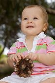 Beautiful And Happy Baby Girl Playing With A Blurry Background