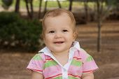 Beautiful And Happy Baby Girl Looking At Camera