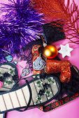 New Year Party Stuff Close Up In Mess On Bright Pink Background, Holiday Gifts Concept poster