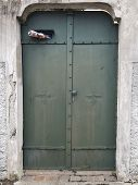 Antique Metal, Green Door. The Front Door, With The Hardened Newspaper In The Door. Antique Door Fro poster