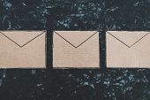 Inbox Organization Conceptual Still-life, Email Envelope Icons Made Of Cardboard Lined Up On A Desk poster
