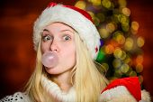 Only Fun On My Mind. Girl Santa Claus Making Big Bubble With Gum. Funny Face Close Up. Adorable Woma poster