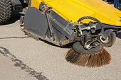 Industrial Sweeper, Road Cleaner With Brushes. Brushing The Road. The Concept Of Community Road Serv poster