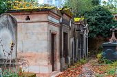 A View On Autumn Alley Of The Most Famous Cemetery Of Paris Pere Lachaise, France. Tombs Of Various  poster