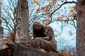 Old Stone Woman Monument In The Most Famous Cemetery Of Paris Pere Lachaise, France. Tombs Of Variou poster
