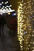 Festive Christmas Illumination At Night On The Street. Bright Golden Yellow Blurry Lights. Christmas poster