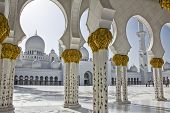 stock photo of allah  - Beautiful columns of Sheikh Zayed Mosque in Abu Dhabi capital of the United Arab Emirates - JPG