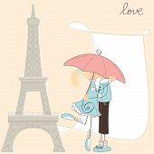 Girl kiss boy under umbrella in Paris