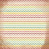 Vector grunge background. Colorful zig-zag chevron pattern.