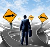 image of confusing  - Strategic journey as a business man with a breifcase choosing the right strategic path for a new career with blank yellow traffic signs with arrows tangled roads and highways in a confused direction - JPG
