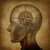 foto of moral  - Moral compass and career path concept with a human head and a compass as a brain on a grunge old parchment texture - JPG