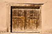 Old Door In Adobe Wall
