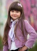 Portrait Of Little Girl Outdoors