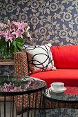 stock photo of gobelin  - Beautiful basketwork furniture in front of gobelin - JPG