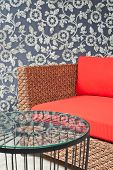 image of gobelin  - Beautiful basketwork furniture in front of gobelin - JPG