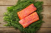 foto of lax  - Two pieces of gravad lax on the table with some greenery - JPG