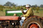 Happy Farmer On Tractor