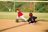 picture of little-league  - Little league baseball player getting an out at second base - JPG