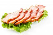 Bacon With Lettuce Leaves On A White Plate