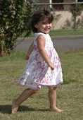 Happy Little Girl Running Looking Directly poster