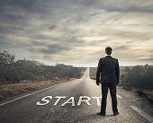 pic of daring  - businessman in front of a deserted road - JPG