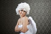 Girl in white angel costume is not in love anymore.