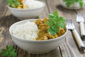 picture of curry chicken  - Chicken curry with rice in a bowl on the table - JPG