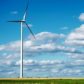 image of wind wheel  - Wind generator turbine on summer landscape - JPG