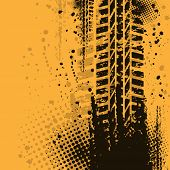 image of skid  - Orange grunge background with black tire track - JPG