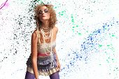 Fashion woman 80's style over paint splatter background