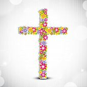 Merry Christmas celebration concept with floral decorated Christian Cross on shiny grey background.