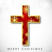 Shiny red and golden Christian Cross on abstract grey background for Merry Christmas celebration background.
