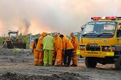 Ningi, Australia - November 9 : Firefighter Crew Dicussing Approaches To Fire Front Of Bush Fire Nov