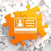 ID Card Icon on Orange Puzzle.