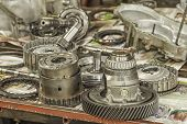 picture of workbench  - Used automatic transmission parts on a workbench.