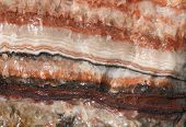 stock photo of calcite  - Rainbow banded coral calcite - JPG