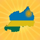 Rwanda map flag on sunburst illustration