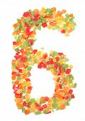 Letters and numbers alphabet from dried fruits on a white background