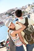 Smiling girl with boyfriend traveling to Ibiza island