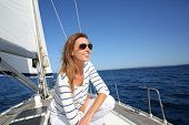 picture of sails  - Attractive modern woman enjoying sailing cruise - JPG