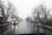 stock photo of rainy day  - rainy window in traffic with car from front - JPG