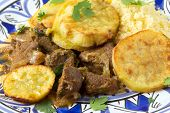 Moroccan sweet potato and beef tagine closeup on a plate. A traditional dish from Fez