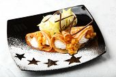 Golden pancakes with carambola and cream