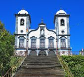 Sights of the Portuguese island of Madeira. Magnificent white church of Nossa-Senior-du-Monty. To th