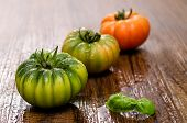 stock photo of crudites  - Italian tomatoes with basil on a wooden table - JPG