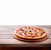 Delicious fresh pizza served on wooden table.