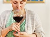 Portrait Of Young Wiman Drinking Red Wine With Eyes Closed